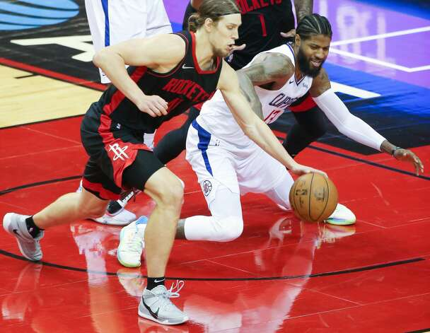 Houston Rockets forward Kelly Olynyk (41) chases a loos ball against LA Clippers center DeMarcus Cousins (15) in the fourth quarter at the Toyota Center in Houston on Friday, April 23, 2021. LA Clippers won the game 109-104. Photo: Elizabeth Conley/Staff Photographer / © 2021 Houston Chronicle