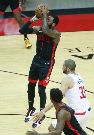 Houston Rockets guard John Wall (1) pulls up for a jump shot against LA Clippers at the Toyota Center in Houston on Friday, April 23, 2021. LA Clippers won the game 109-104. Photo: Elizabeth Conley/Staff Photographer / © 2021 Houston Chronicle