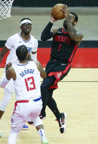 Houston Rockets guard John Wall (1) pulls up for a jumpsuit over LA Clippers guard Paul George (13) in the second half of game action at the Toyota Center in Houston on Friday, April 23, 2021. LA Clippers won the game 109-104. Photo: Elizabeth Conley/Staff Photographer / © 2021 Houston Chronicle