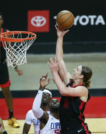 Houston Rockets forward Kelly Olynyk (41) puts up a layup against LA Clippers in the second half of game action at the Toyota Center in Houston on Friday, April 23, 2021. LA Clippers won the game 109-104. Photo: Elizabeth Conley/Staff Photographer / © 2021 Houston Chronicle