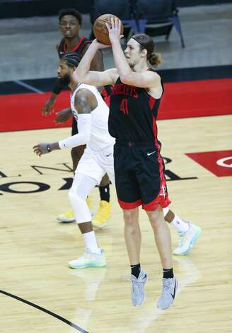 Houston Rockets forward Kelly Olynyk (41) pulls up for a three-point-shot in the fourth quarter against the LA Clippers at the Toyota Center in Houston on Friday, April 23, 2021. LA Clippers won the game 109-104. Photo: Elizabeth Conley/Staff Photographer / © 2021 Houston Chronicle