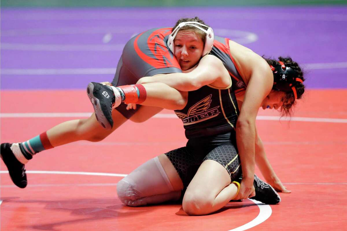 Emily Trevino with Mission Sharyland Pioneer, top, is taken down by Madison Canales with Richmond Foster in the 119 weight class of the UIL Girls 5A State Wrestling Championships Friday, Apr. 23, 2021 at the Berry Center in Cypress, TX.