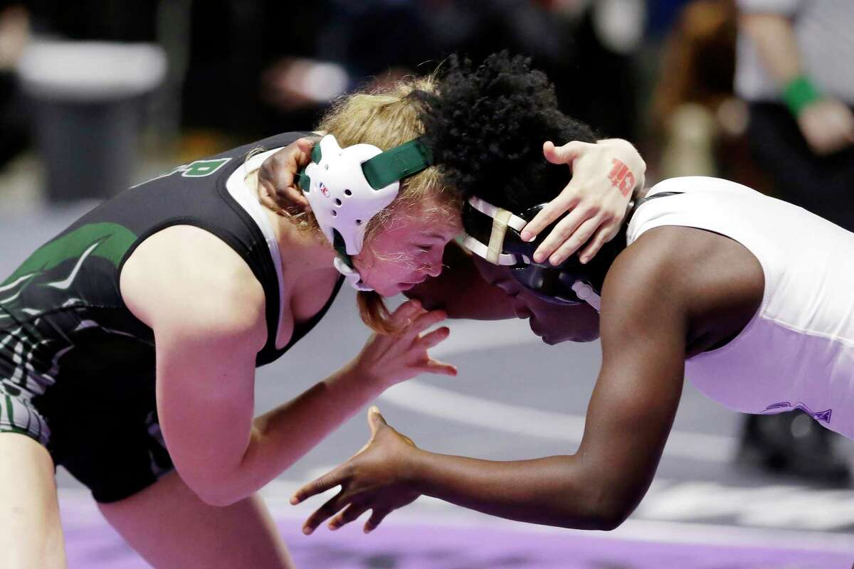 Maddie Sandquist with Humble Kingwood Park, left, and Maya Lewis with Dallas Sunset, right, in their 138 weight class third place match of the UIL Girls 5A State Wrestling Championships Friday, Apr. 23, 2021 at the Berry Center in Cypress, TX.