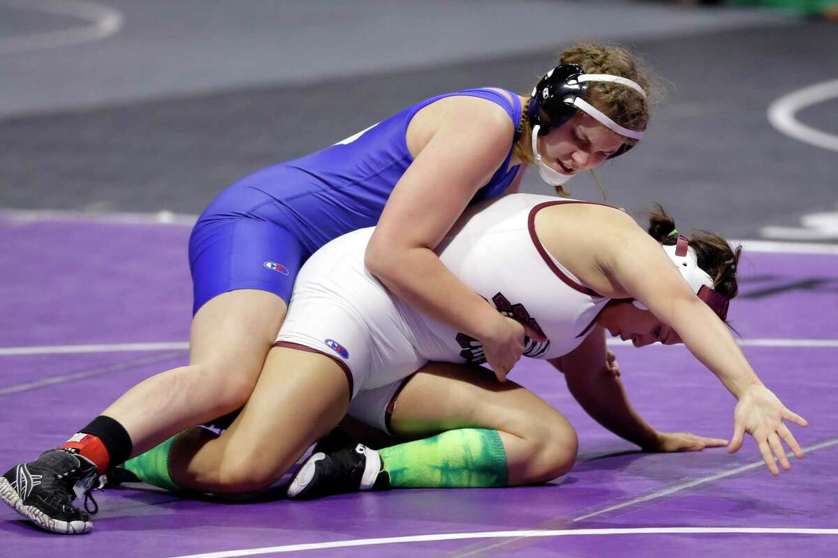Freshman Avery Beckman of Friendswood takes down Jazmine Garcia of El Paso Ysleta in their 148-pound weight class championship match at the UIL Girls 5A State Wrestling Championships Friday at the Berry Center.