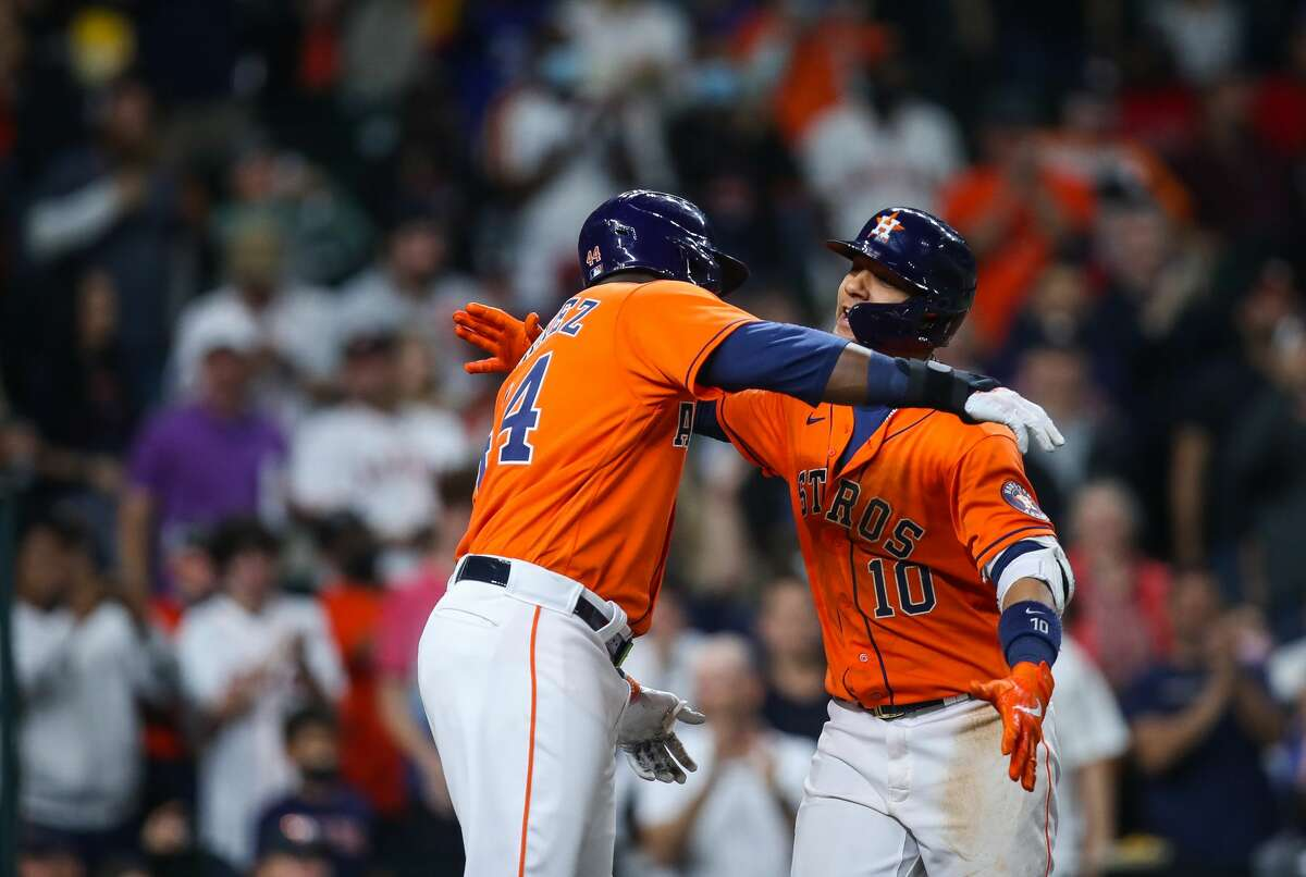 Houston Astros first baseman Yuli Gurriel (10) celebrates with designated hitter Yordan Alvarez (44) after hitting a two-RBI home run against the Los Angeles Angels during the seventh inning of an MLB game at Minute Maid Park on Friday, April 23, 2021, in Houston.