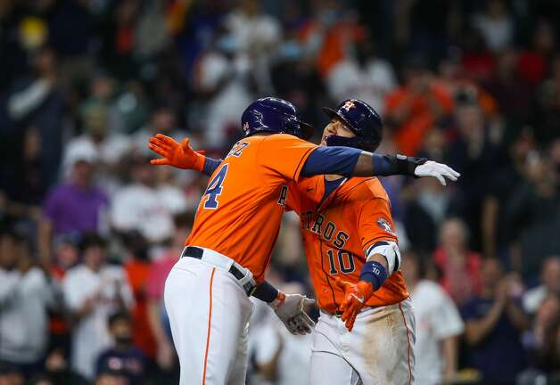 Houston Astros first baseman Yuli Gurriel (10) celebrates with designated hitter Yordan Alvarez (44) after hitting a two-RBI home run against the Los Angeles Angels during the seventh inning of an MLB game at Minute Maid Park on Friday, April 23, 2021, in Houston. Photo: Godofredo A Vásquez/Staff Photographer / © 2021 Houston Chronicle