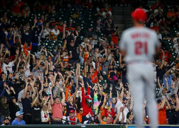 Fans participate in the wave during the eighth inning of an MLB game between the Houston Astros and the Los Angeles Angels at Minute Maid Park on Friday, April 23, 2021, in Houston. Photo: Godofredo A Vásquez/Staff Photographer / © 2021 Houston Chronicle