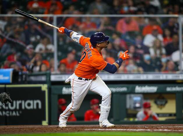 Houston Astros first baseman Yuli Gurriel (10) hits a two-RBI home run against the Los Angeles Angels during the seventh inning of an MLB game at Minute Maid Park on Friday, April 23, 2021, in Houston. Photo: Godofredo A Vásquez/Staff Photographer / © 2021 Houston Chronicle