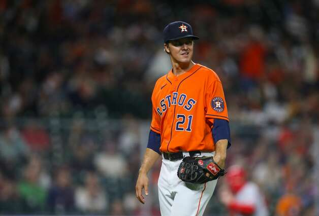 Houston Astros starting pitcher Zack Greinke (21) walks to the dugout after his sixth strike out of the game against the Los Angeles Angels during the sixth inning of an MLB game at Minute Maid Park on Friday, April 23, 2021, in Houston. Photo: Godofredo A Vásquez/Staff Photographer / © 2021 Houston Chronicle