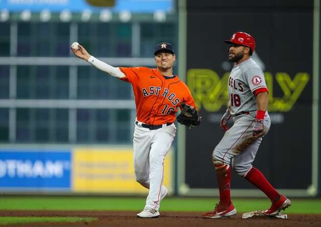 Houston Astros second baseman Aledmys Diaz (16) turns a double play against the Los Angeles Angels during the sixth inning of an MLB game at Minute Maid Park on Friday, April 23, 2021, in Houston. Photo: Godofredo A Vásquez/Staff Photographer / © 2021 Houston Chronicle