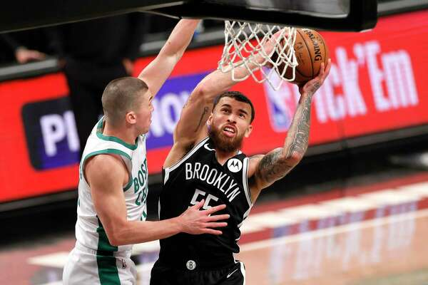 NEW YORK, NEW YORK - APRIL 23: Mike James #55 of the Brooklyn Nets goes to the basket as Payton Pritchard #11 of the Boston Celtics defends during the second half at Barclays Center on April 23, 2021 in the Brooklyn borough of New York City. The Nets won 109-104. NOTE TO USER: User expressly acknowledges and agrees that, by downloading and or using this photograph, User is consenting to the terms and conditions of the Getty Images License Agreement. (Photo by Sarah Stier/Getty Images)