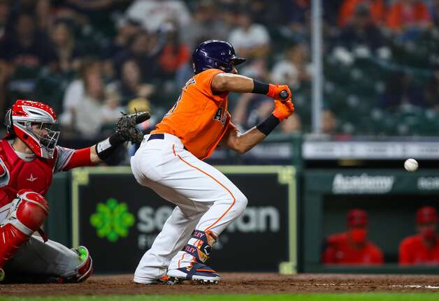 Houston Astros left fielder Michael Brantley (23) lays down a bunt against the Los Angeles Angels during the ninth inning of an MLB game at Minute Maid Park on Friday, April 23, 2021, in Houston. Photo: Godofredo A Vásquez/Staff Photographer / © 2021 Houston Chronicle