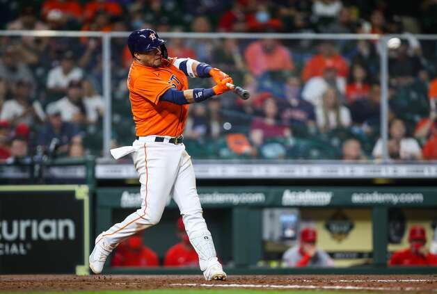 Houston Astros first baseman Yuli Gurriel (10) hits a single to right field against the Los Angeles Angels during the ninth inning of an MLB game at Minute Maid Park on Friday, April 23, 2021, in Houston. Photo: Godofredo A Vásquez/Staff Photographer / © 2021 Houston Chronicle
