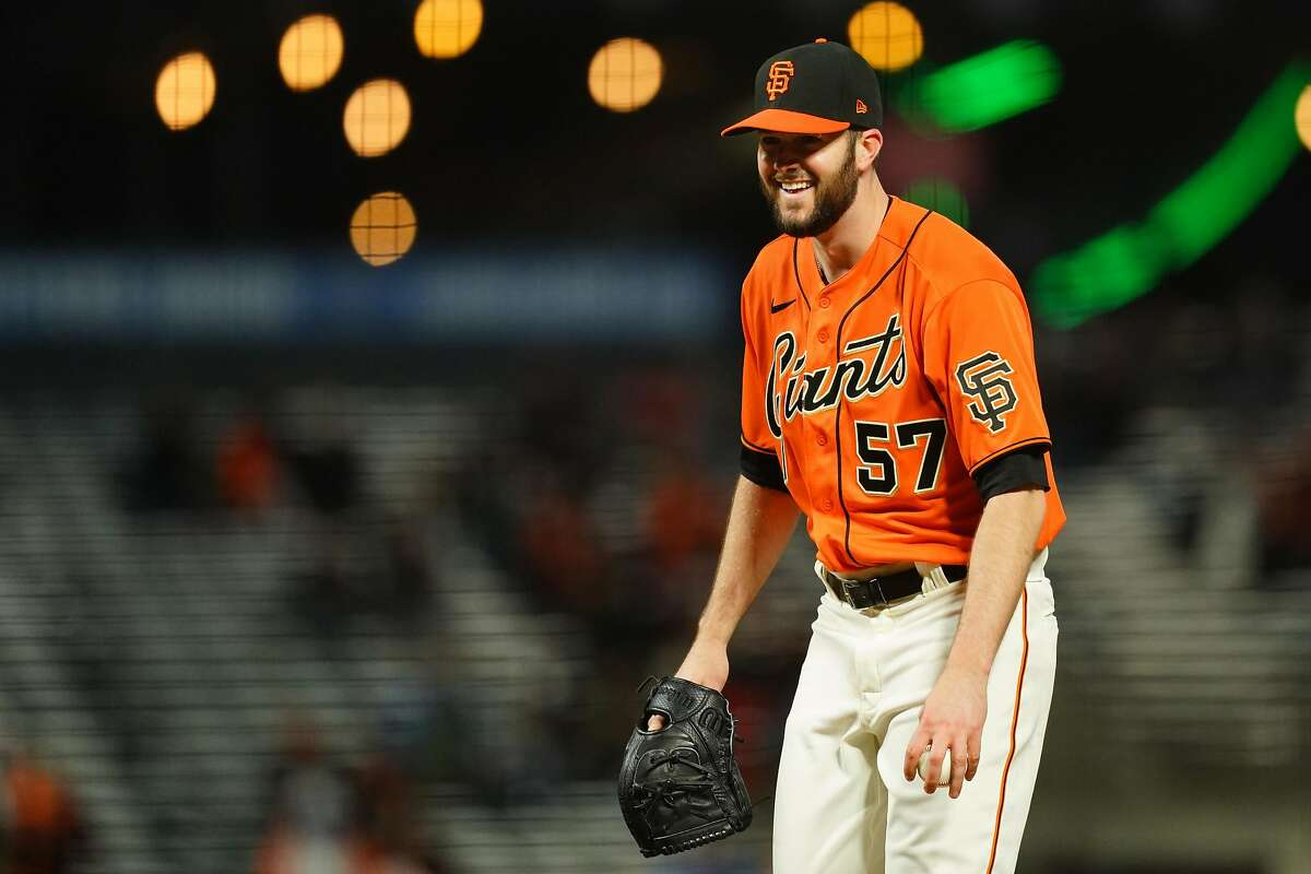 Starter Alex Wood of the Giants reacts after catching a line drive by Jazz Chisholm Jr. of the Marlins in the sixth at Oracle Park. Wood allowed a home run to Chisholm in the