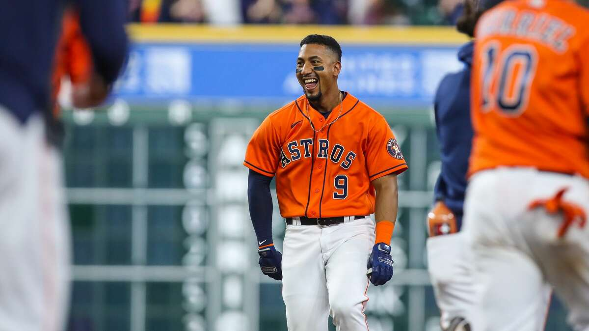 Houston Astros second baseman Robel Garcia (9) drives the winning run with a single to center field during the 10th inning of an MLB game against the Los Angeles Angels at Minute Maid Park on Friday, April 23, 2021, in Houston. The Astros won 5-4.