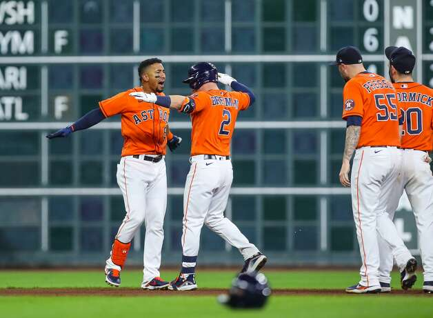 Houston Astros second baseman Robel Garcia (9) celebrates after driving in the winning run with a single to center field during the 10th inning of an MLB game against the Los Angeles Angels at Minute Maid Park on Friday, April 23, 2021, in Houston. The Astros won 5-4. Photo: Godofredo A Vásquez/Staff Photographer / © 2021 Houston Chronicle