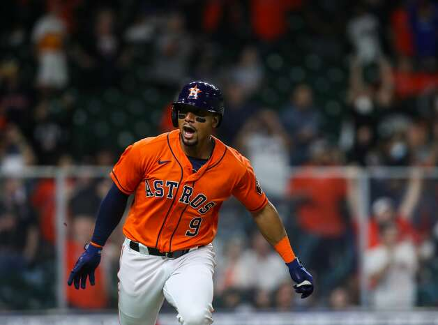 Houston Astros second baseman Robel Garcia (9) drives in the winning run with a single to center field during the 10th inning of an MLB game against the Los Angeles Angels at Minute Maid Park on Friday, April 23, 2021, in Houston. The Astros won 5-4. Photo: Godofredo A Vásquez/Staff Photographer / © 2021 Houston Chronicle