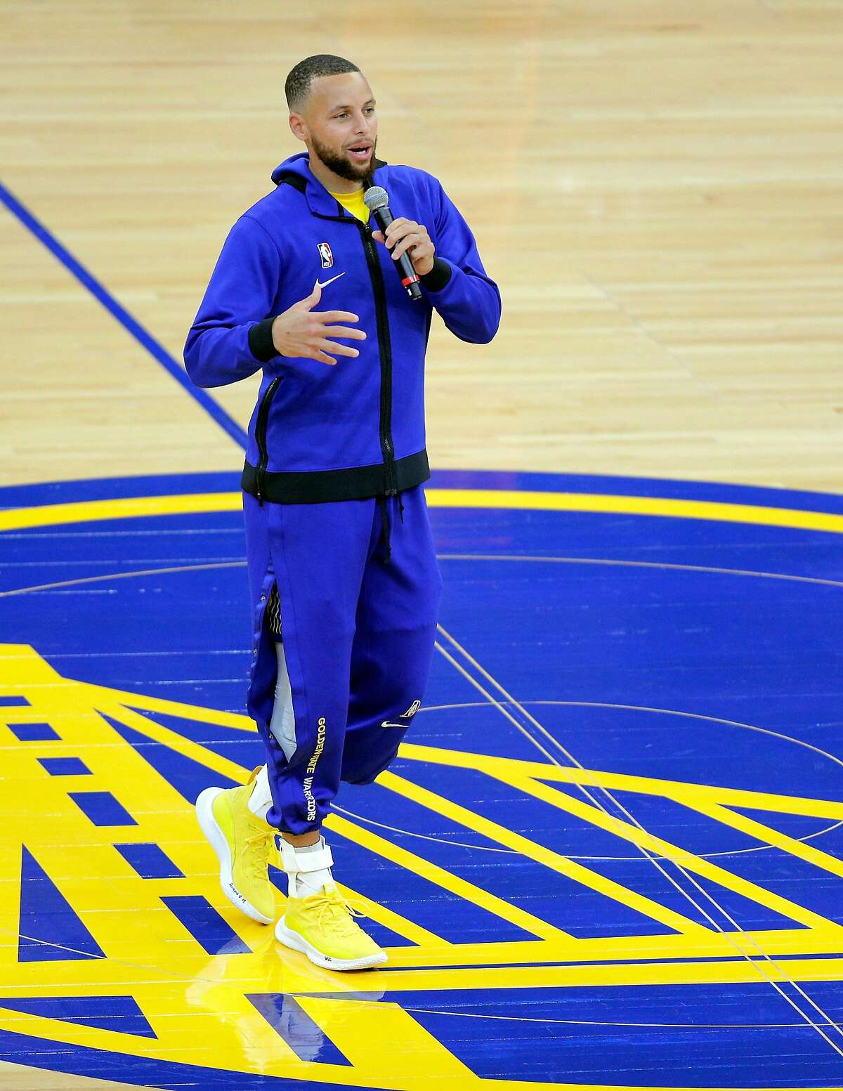 Stephen Curry (30) addresses the fans after they returned to Chase Center for the first time in 409 games before the Golden State Warriors played the Denver Nuggets in San Francisco, Calif., on Friday, April 23, 2021.