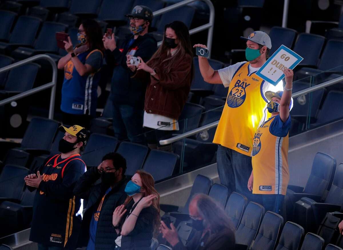 Warriors fans sit distanced and masked as they returned to the arena for the first time in 409 games.