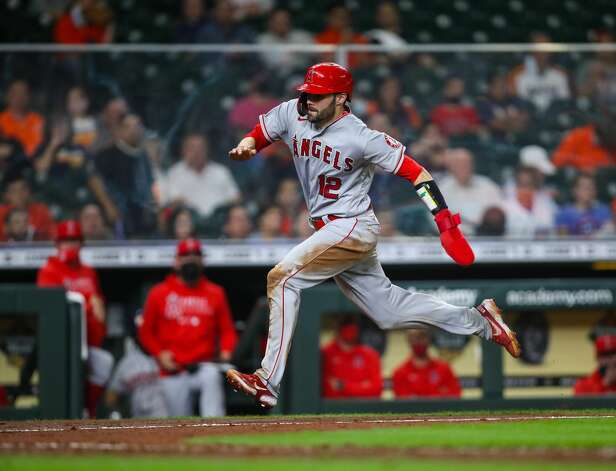 Los Angeles Angels catcher Anthony Bemboom (12) scores on an RBI single hit by second baseman David Fletcher (22) during the 10th inning of an MLB game against the Houston Astros at Minute Maid Park on Friday, April 23, 2021, in Houston. The Astros won 5-4. Photo: Godofredo A Vásquez/Staff Photographer / © 2021 Houston Chronicle