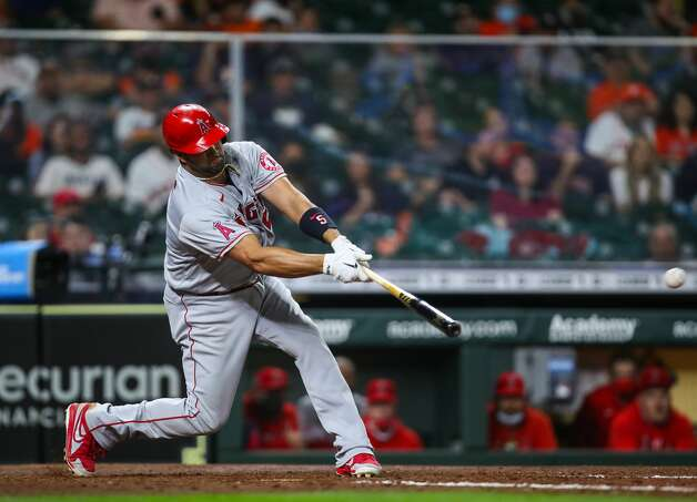 Los Angeles Angels first baseman Albert Pujols (5) hits an RBI single to center field during the 10th inning of an MLB game against the Houston Astros at Minute Maid Park on Friday, April 23, 2021, in Houston. Photo: Godofredo A Vásquez/Staff Photographer / © 2021 Houston Chronicle