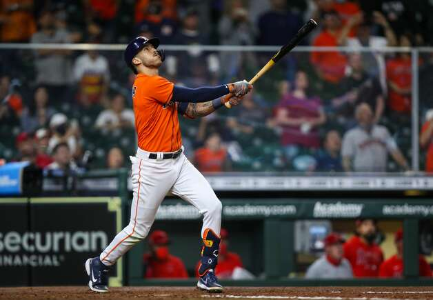 Houston Astros shortstop Carlos Correa (1) hits a sacrifice fly to right field against the Los Angeles Angels during the 10th inning of an MLB game at Minute Maid Park on Friday, April 23, 2021, in Houston. The Astros won 5-4. Photo: Godofredo A Vásquez/Staff Photographer / © 2021 Houston Chronicle
