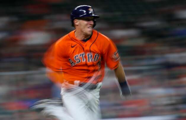 Houston Astros center fielder Myles Straw (3) beats out the throw to first base on a ground ball hit to third base during the 10th inning of an MLB game against the Los Angeles Angels at Minute Maid Park on Friday, April 23, 2021, in Houston. The Astros won 5-4. Photo: Godofredo A Vásquez/Staff Photographer / © 2021 Houston Chronicle