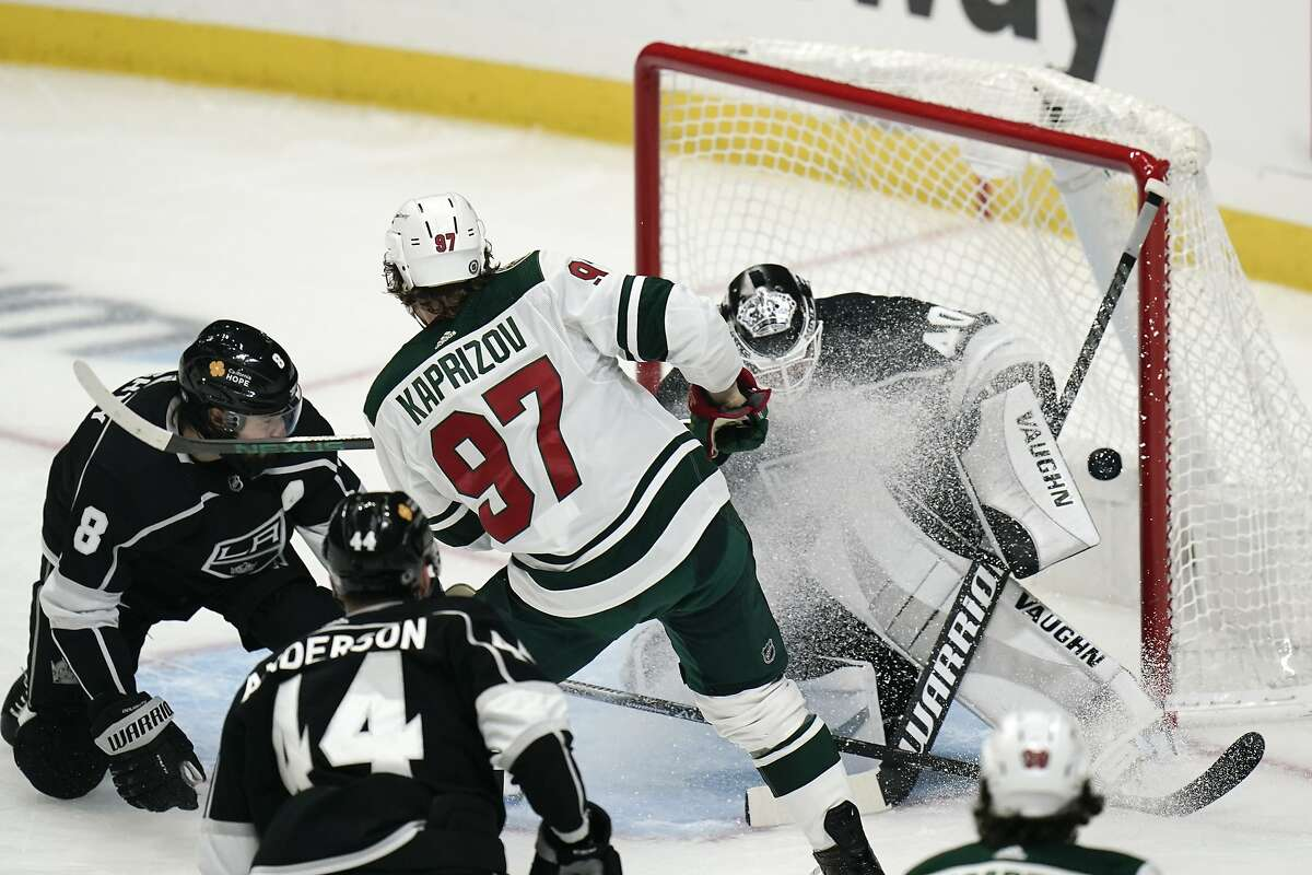 Minnesota's Kirill Kaprizov (97) scores in traffic past Los Angeles goaltender Calvin Petersen for a goal during the first period of an NHL hockey game Friday, April 23, 2021, in Los Angeles. (AP Photo/Jae C. Hong)