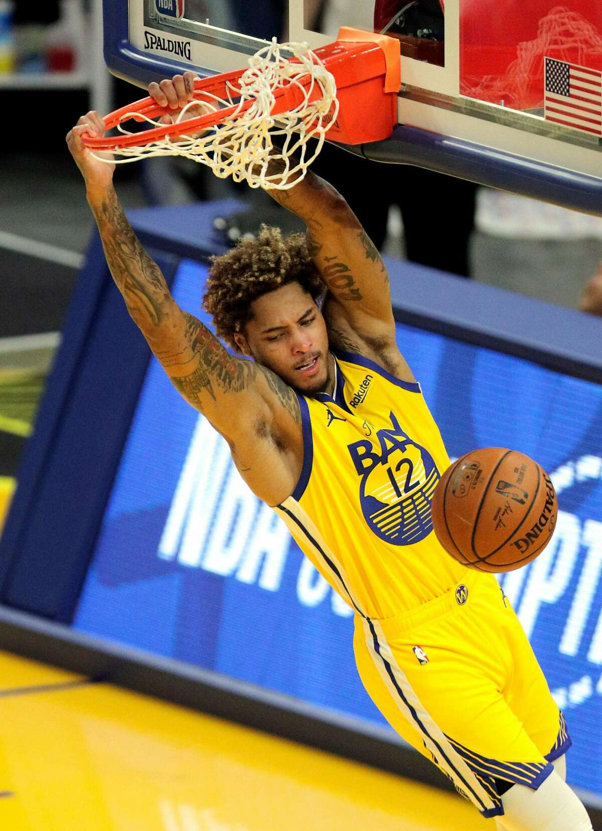 Kelly Oubre Jr. (12) dunks in the second half as the Golden State Warriors played the Denver Nuggets at Chase Center in San Francisco, Calif., on Friday, April 23, 2021. The COVID-19 pandemic stopped all live events including sports and only recently have venues been allowed to have limited attendance.