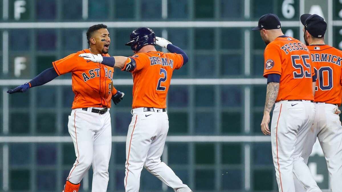 Houston Astros second baseman Robel Garcia (9) celebrates after drive in the winning run with a single to center field during the 10th inning of an MLB game against the Los Angeles Angels at Minute Maid Park on Friday, April 23, 2021, in Houston. The Astros won 5-4.