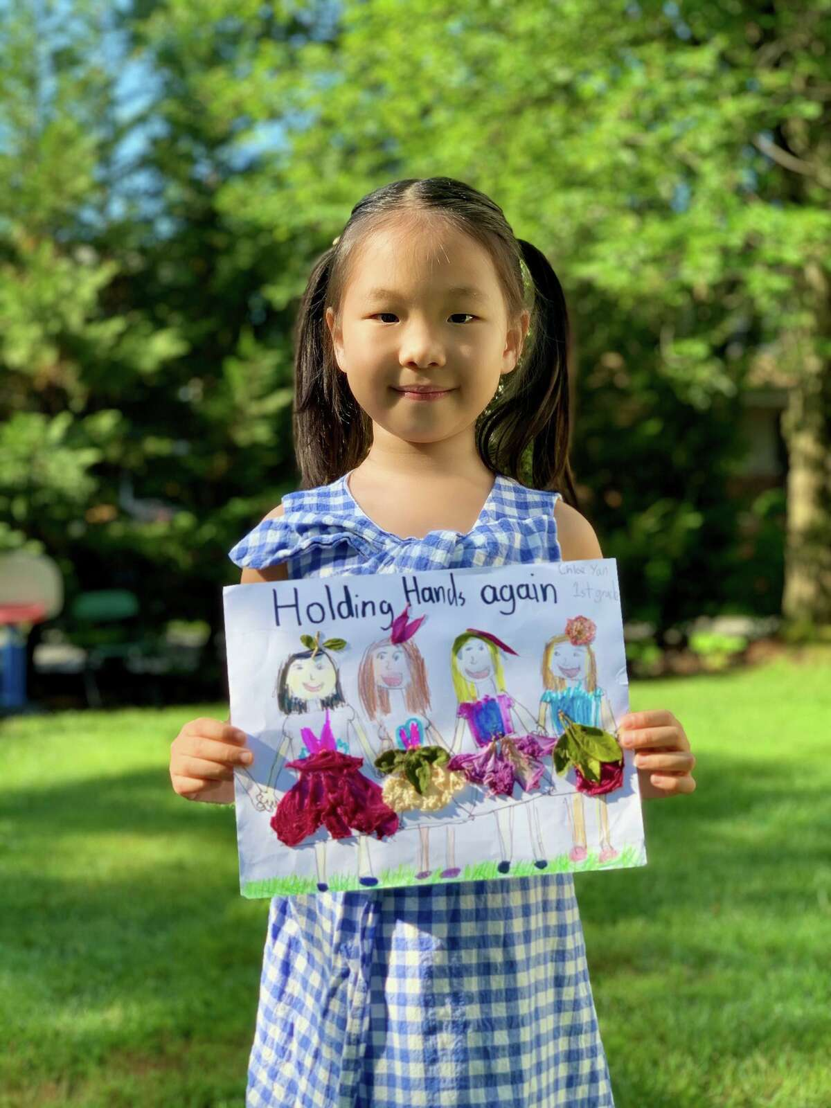 First-grader Chloe Yan with her award-winning entry in a 2020 Bruce Museum art contest seeking a response to the prompt: