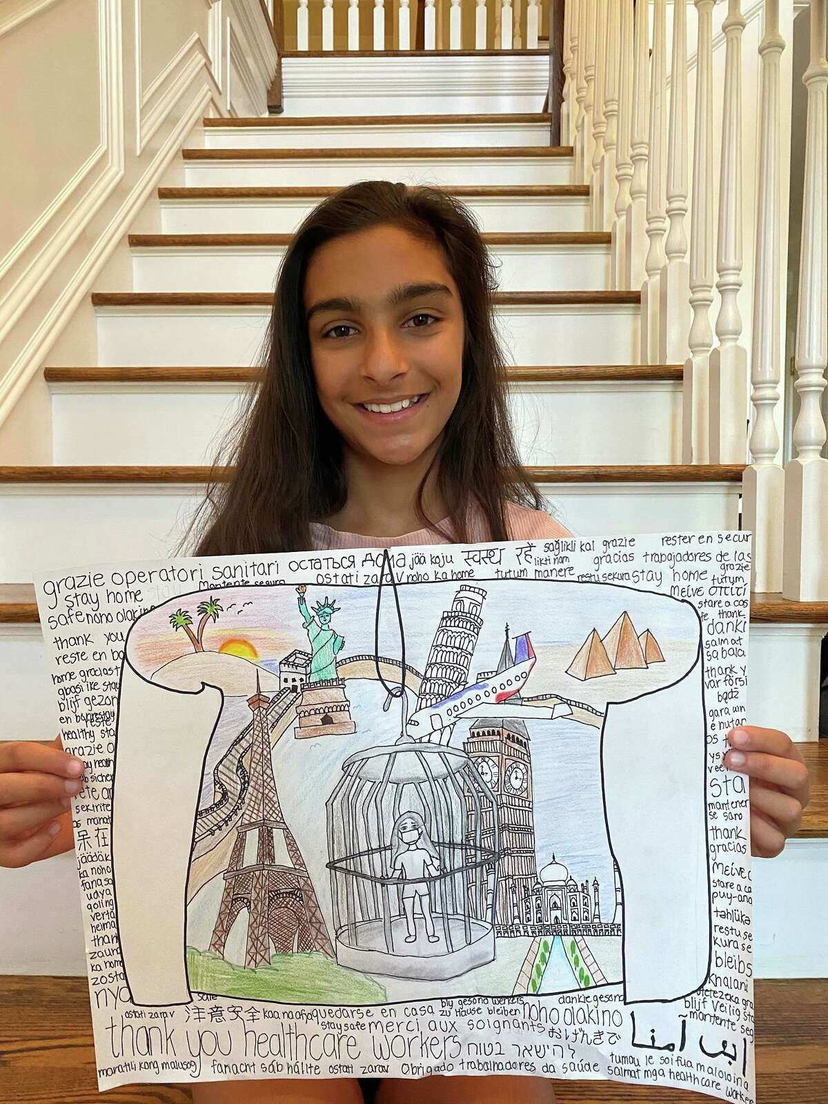Sixth-grader Yana Thukral with her award-winning entry in a 2020 Bruce Museum art contest seeking a response to the prompt: