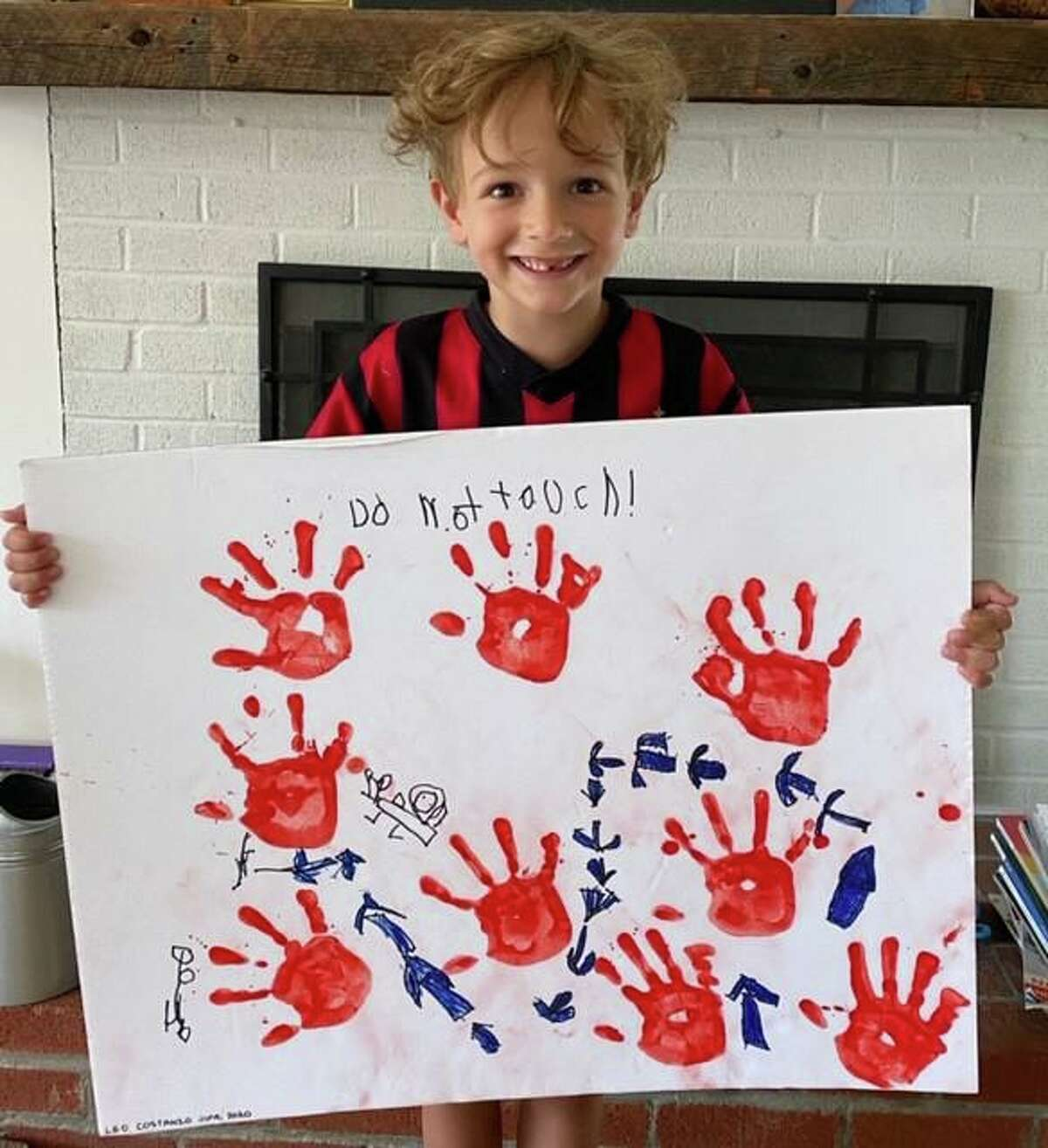 Kindergartner Leonardo Costanzo with his award-winning entry in a 2020 Bruce Museum art contest seeking a response to the prompt: