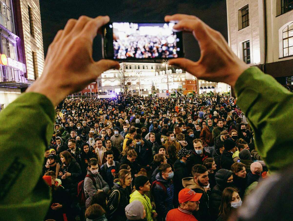 Hundreds of people gather at a pro-Navalny protest in the city center of Moscow on Wednesday.