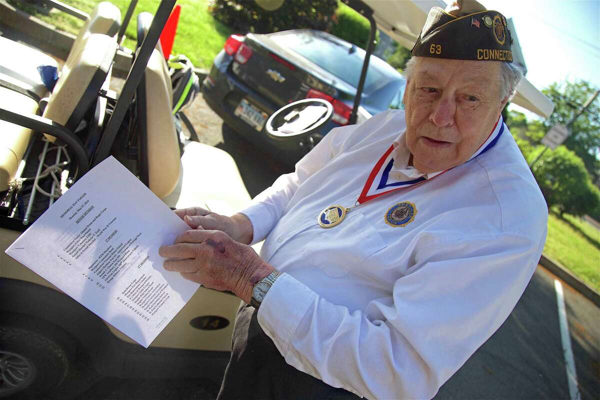"""Bill Vornkahl, """"Mr. Parade,"""" a Korean War veteran who has organized the parades for almost 50 years, looks over the plans, at the Memorial Day parade on May 27, 2019, in Westport."""