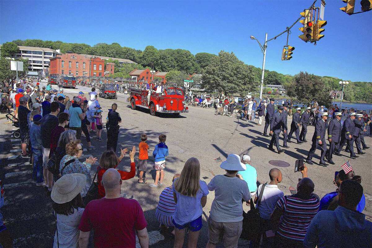 The crowd watches firetrucks crossing the Post Road bridge at the Memorial Day parade on May 27, 2019, in Westport.