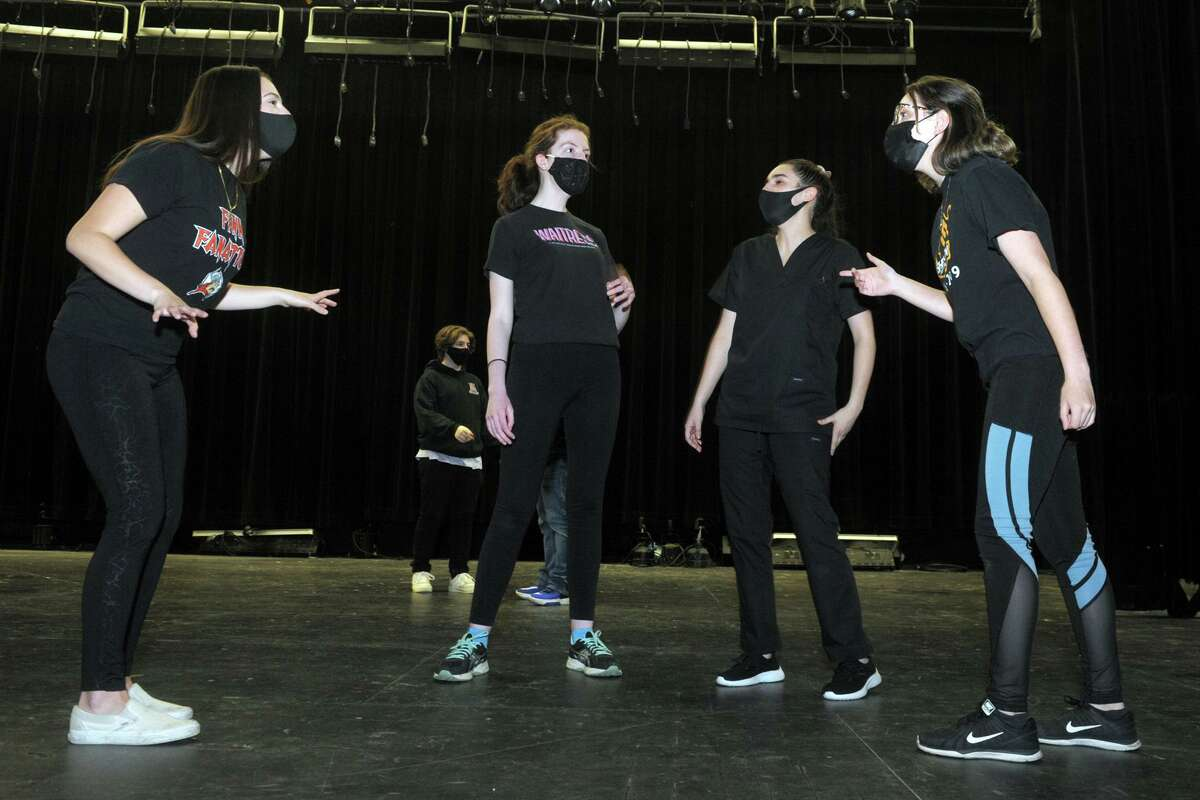 The Shelton High School drama club rehearse for their upcoming musical review in Shelton, Conn. April 22, 2021.