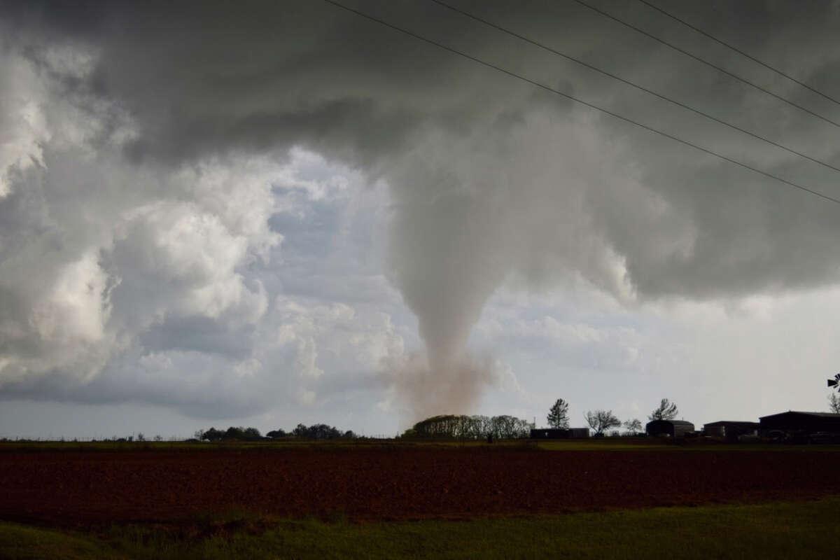 A cone-shaped tornado whirls near Lockett, Texas, on Friday.