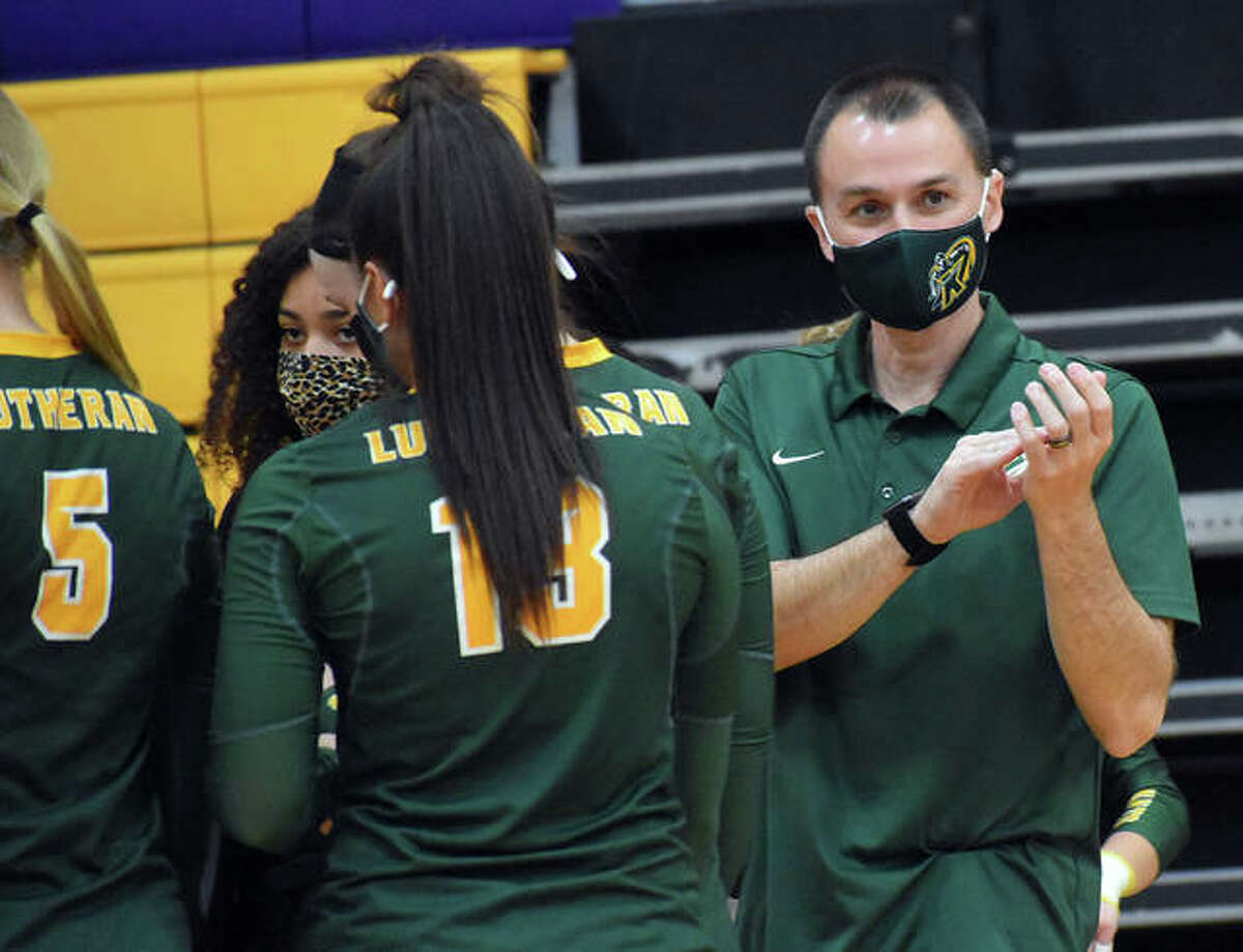 Metro-East Lutheran coach Jon Giordano applauds the Civic Memorial Eagles and the crowd after Friday's match in Bethalto.