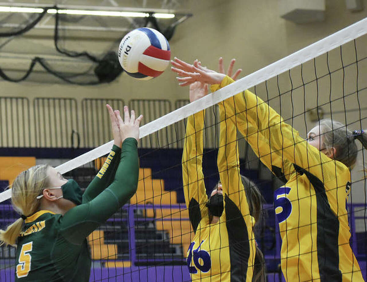 Metro-East Lutheran's Peyton Ashauer, left, goes up for the ball against Civic Memorial's Camryn Gehrs, center, and Annabelle Reno.