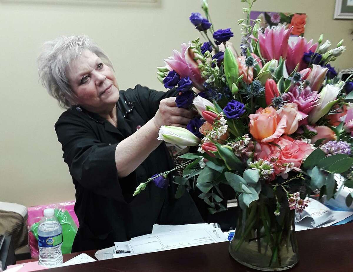Master Designer Lana King prepares one of her custom arrangements for an area client. King and her husband Samuel own Blooms From The Heart in Cypress and are survivors of the pandemic and freeze.