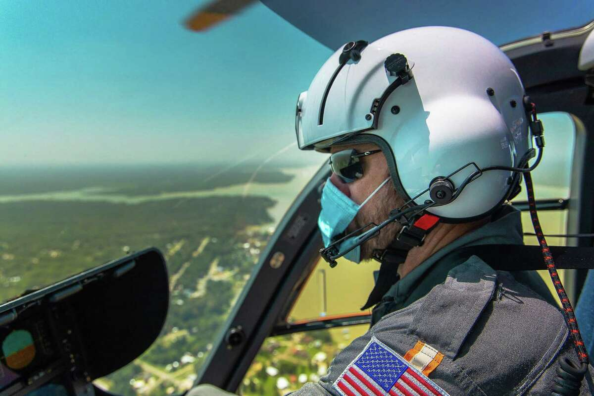 HCA Houston Healthcare AirLife pilot Mike Erickson keeps an eye on his target landing helipad in preparation for transporting a critically injured patient.