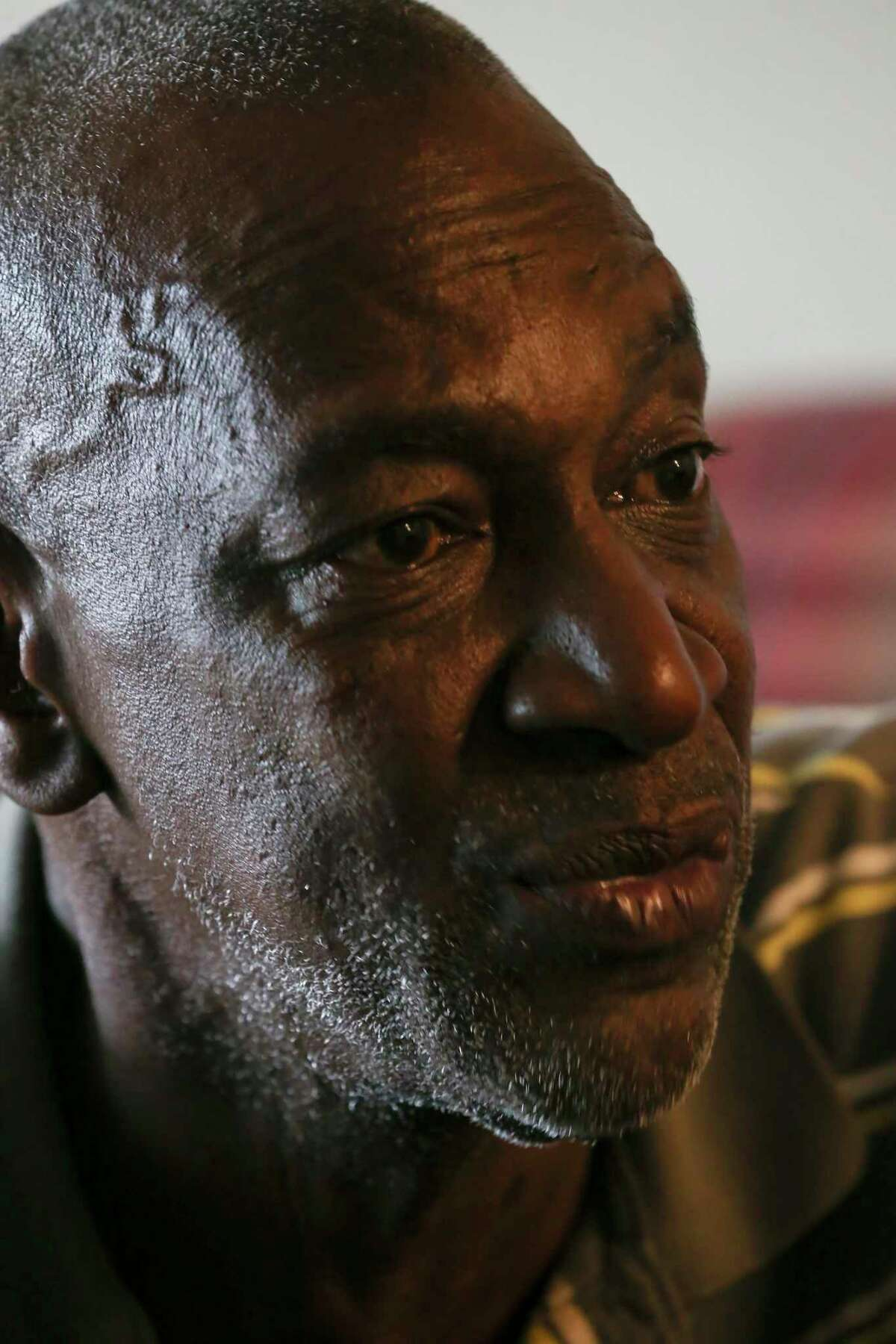 Larry McCoy, 57, reflects on his life during an interview at his apartment, Friday, April 23, 2021. McCoy, a nine-year Air Force veteran who served in Desert Storm, was homeless, not for the first time, when he was kicked out of a previous apartment in July 2019. Suffering from depression and schizophrenia, he was able to rent the apartment with help from the Veteran Affairs Supportive Housing Voucher program. He moved into the apartment in August 2019.
