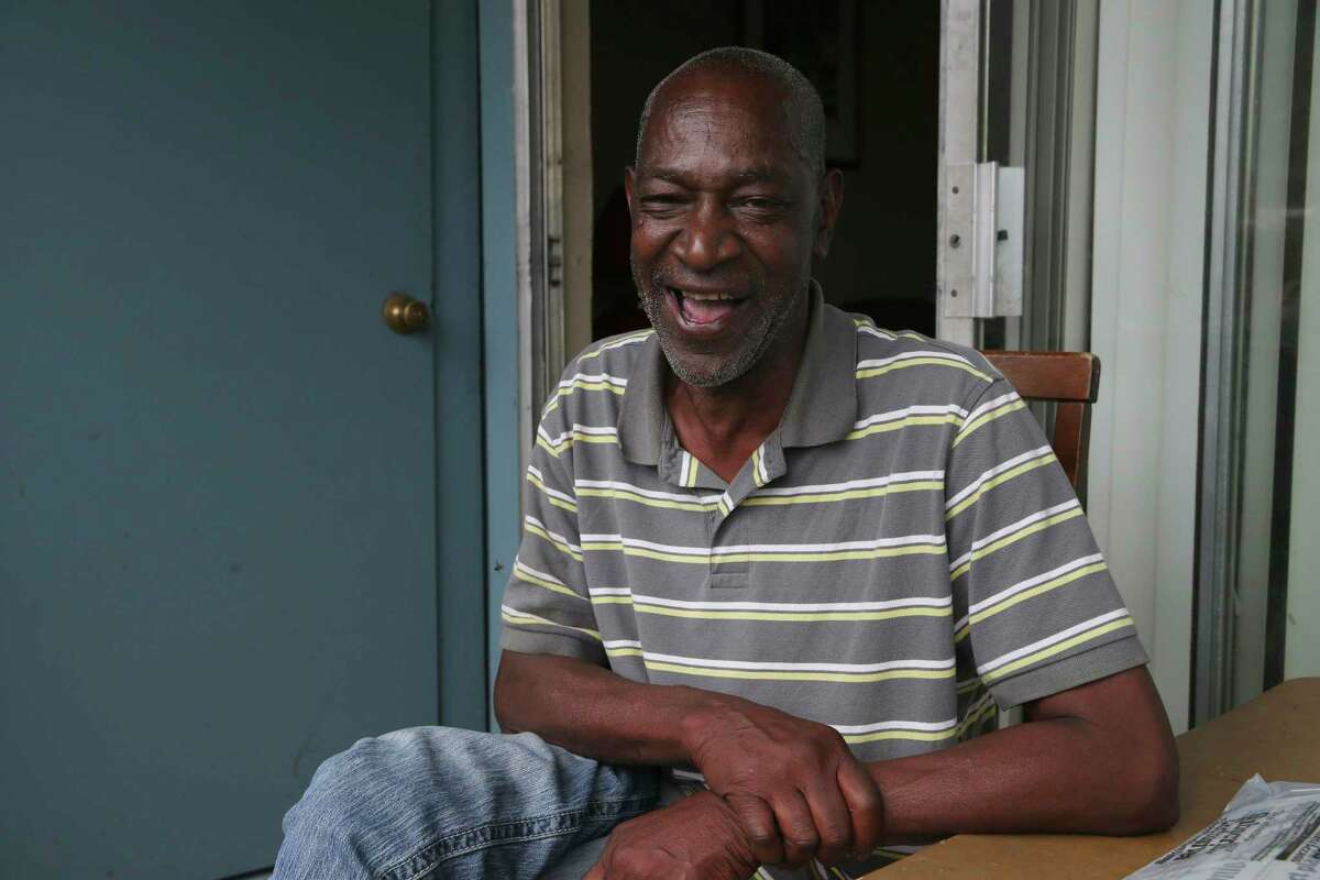 Larry McCoy, 57, smiles as he talks about his apartment, Friday, April 23, 2021. McCoy, a nine-year Air Force veteran who served in Desert Storm, was homeless, not for the first time, when he was kicked out of a previous apartment in July 2019. Suffering from depression and schizophrenia, he was able to rent the apartment with help from the Veteran Affairs Supportive Housing Voucher program. He moved into the apartment in August 2019.