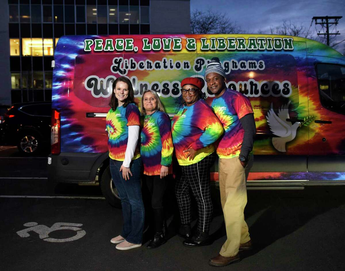 From left, Liberation Programs Director of Development and Communications Fiona Wilkes, Chief Clinical Officer Joanne Montgomery, Recovery Coach Glennard Brown, and Chief Recovery Officer Maggie Young pose by the Mobile Wellness Van in the parking lot at the YMCA in Greenwich, Conn. Tuesday, Jan. 21, 2020. The Mobile Wellness Van will begin to make regular stops in town next month.