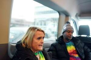 Liberation Programs Chief Clinical Officer Joanne Montgomery and Recovery Coach Glennard Brown chat inside the Mobile Wellness Van in the parking lot at the YMCA in Greenwich, Conn. Tuesday, Jan. 21, 2020. The Mobile Wellness Van travels throughout Fairfield County to provide on-the-street services to those struggling with opiates.