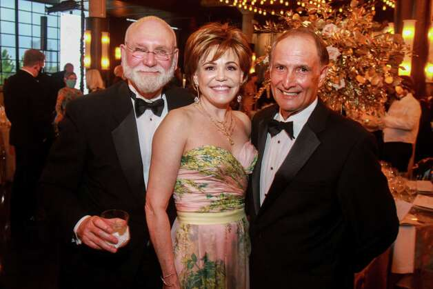 Michael Francisco, from left, Hallie Vanderhider and Glenn Reyes at the Houston Symphony Wine Auction and Collector's Dinner on April 23, 2021. Photo: Gary Fountain, Contributor / Copyright 2021 Gary Fountain