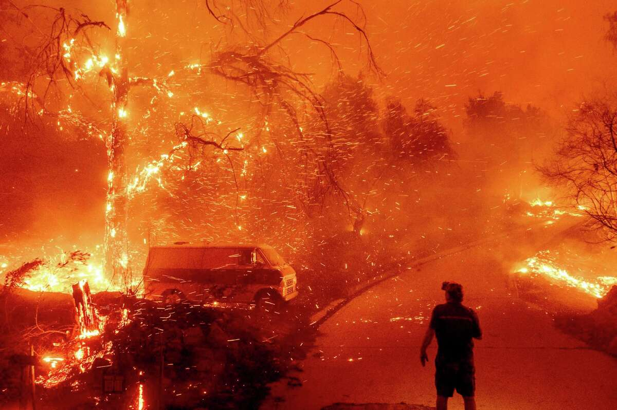 Embers fly as the Bond Fire burns through the Silverado community in Orange County last year.