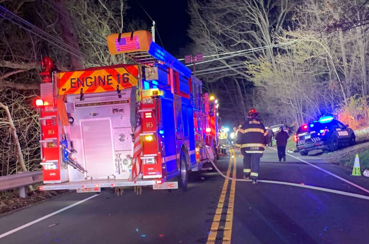 Fire crews at the scene of a two-vehicle head-on collision on Route 34 in Seymour, Conn., that left three people, including a toddler, dead on Wednesday, April 21, 2021.