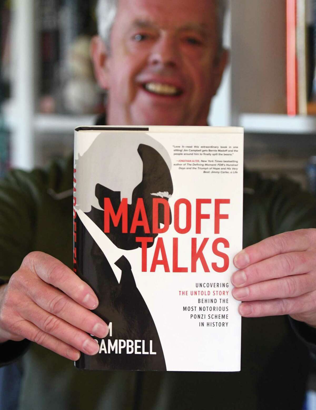 """WGCH host Jim Campbell holds his new book """"Madoff Talks"""" at his home in Old Greenwich, Conn. Thursday, April 22, 2021. Campbell has written a comprehensive new book about notorious Ponzi scheme fraudster Bernie Madoff that is hitting shelves next week coincidentally just after Madoff passed away in prison. Campbell is in the middle of a major publicity tour, including features in the NY Times and CBS Sunday Morning."""
